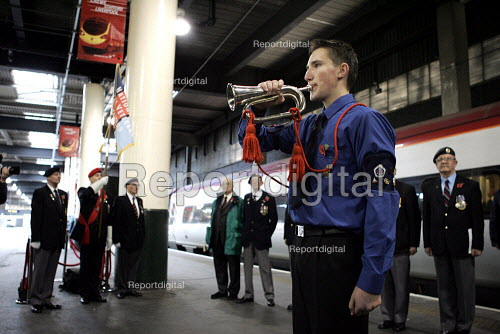 Sounding last post with members of the National Service veterans association. Remembrance service, Euston Station London - Duncan Phillips - 2004-11-10