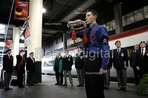 Sounding last post to members of the National Service veterans association. Remembrance service Euston station London - Duncan Phillips - 2004-11-10