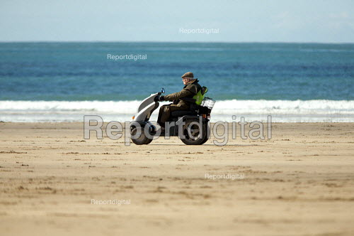 Elderly gent in motorised wheelchair, Whitesands , Pembrokeshire, Wales - Duncan Phillips - 2009-04-11