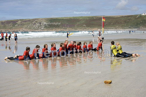 Surfing instructor with beginners, Surf School, Sennen Cove, Cornwall - Duncan Phillips - 2010-08-18