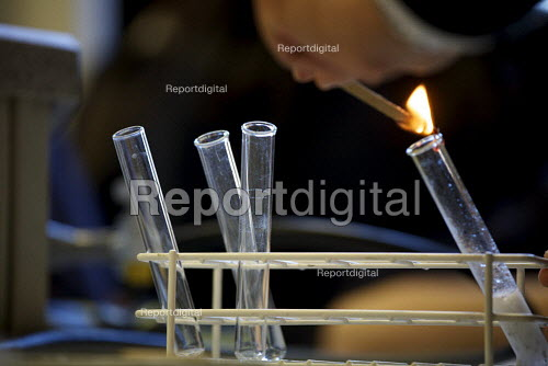Pupils at a London comprehensive secondary school conducting a flame test in a test tube during a science lesson. - Duncan Phillips - 2010-11-26