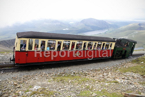 Snowdon Mountain Railway, a narrow gauge rack and pinion mountain railway steam locomotive, It is a tourist railway that travels for 4.7 miles (7.6 �km) from Llanberis to the summit of Snowdon Snowdonia National Park, North Wales. - Duncan Phillips - 2011-08-03