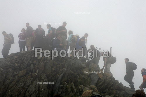 Walkers at the summit of Mount Snowdon, at Snowdonia National Park, North Wales. - Duncan Phillips - 2011-08-03