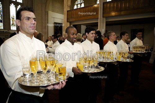 Catering staff serving drinks at the Guildhall, London Wine on trays. - Duncan Phillips - 2009-04-27