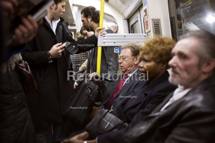 Passengers on the London Tube Train - Duncan Phillips - 2007-02-19