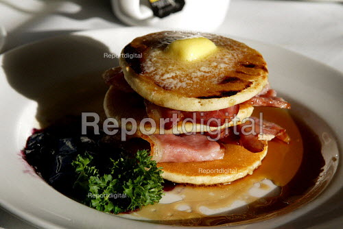 Pancake, butter and bacon breakfast in a dinning car on a train. - Duncan Phillips - 2006-01-19