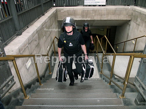 Police in protective clothing attend Bank station which was evacuated in the rush hour due to a security alert. - Duncan Phillips - 2005-07-15