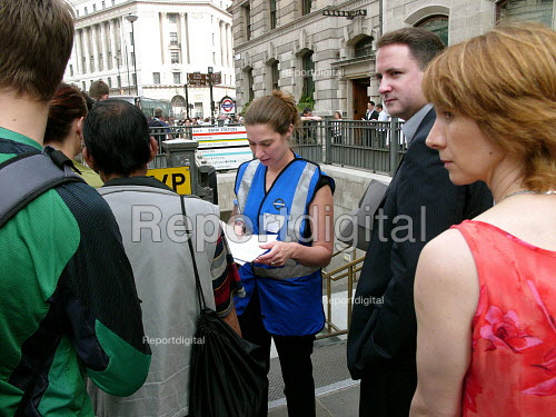 London Underground staff advising commuters at Bank station which was evacuated in the rush hour due to a security alert. - Duncan Phillips - 2005-07-15