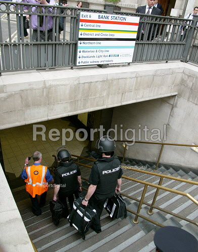 Staff leading Police in protective clothing as they attend Bank station which was evacuated in the rush hour due to a security alert. - Duncan Phillips - 2005-07-15