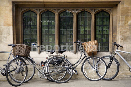 Students bicycles chained outside a college window Cambridge. - Duncan Phillips - 2010-09-17