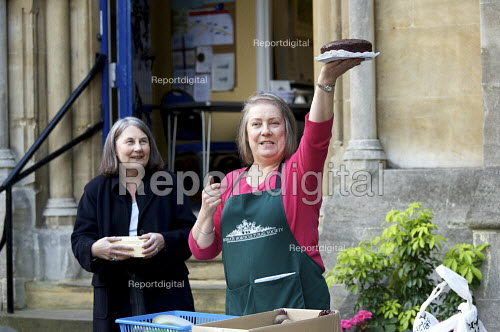 Volunteer from Highgate Horticultural Society selling home made chocolate cake and vegetables, at their Autumn Show stall, The United Refomed Church, Highgate, london - Duncan Phillips - 2010-09-18
