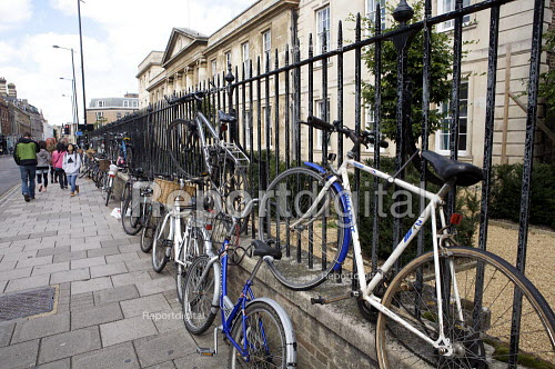 Students bicycles chained outside Emmanuel College Cambridge. - Duncan Phillips - 2010-09-17
