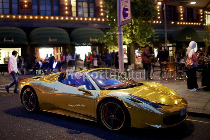 Chrome gold Ferrari 458 Spider supercar parked outside Harrods, Kensington, London. Owned by Kick boxing champion Iraqi Riyadh Al Azzawi - Duncan Phillips - 2015-08-04