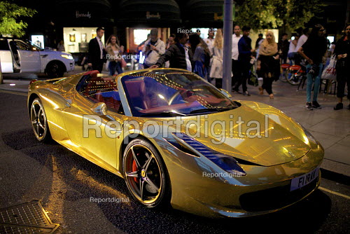 Chrome gold Ferrari 458 Spider supercar parked outside Harrods, Kensington, London. Owned by Kick boxing champion Iraqi Riyadh Al Azzawi - Duncan Phillips - 2015-08-04