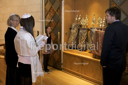 Bat Mitzvah coming of age ceremony before the Arc, containing the Torah scrolls, the sacred scrolls of Judaism used in the public worship of the synagogue. The Liberal Jewish Synagogue, London - Duncan Phillips - 2010-03-18