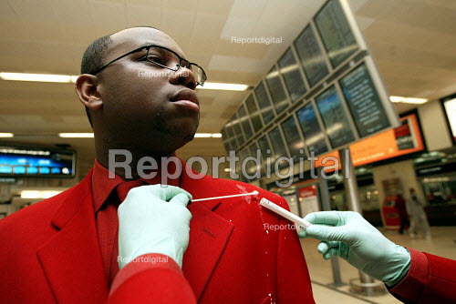 Railway staff using a swab to collect DNA evidence of aggression by travelling public. - Duncan Phillips - 2004-10-20