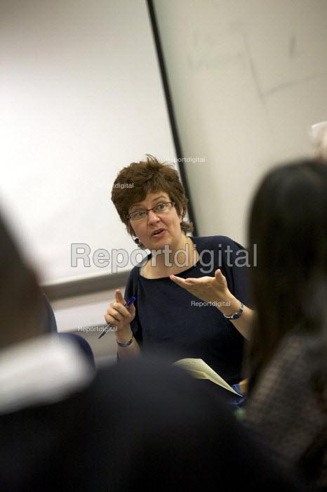 University professor teaching an evening class in creative writing. - Duncan Phillips - 2008-05-29