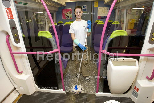 A Bulgarian cleaner cleaning a train. - Duncan Phillips - 2006-10-24