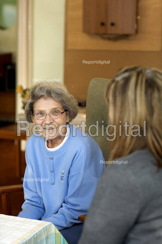 An Elderly lady with carer in sheltered accommodation - Duncan Phillips - 2010-01-21
