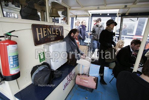 Commuters on board the Henley (1895) which runs a river boat service daily from Putney to Blackfriers. The servive is to be replaced by Thames Clippers in April 2013 - Duncan Phillips - 2013-03-26