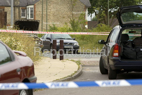 Anti terrorist police search an abandoned car, with hood up, believed to belong to suicide bomber. East Finchley London - Duncan Phillips - 2005-07-26