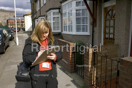 Environmental Health Officer conducting a heating assessment of an elderly couple at home, who use portable heaters to keep warm because their rented house has no central heating. - Duncan Phillips - 2006-03-22