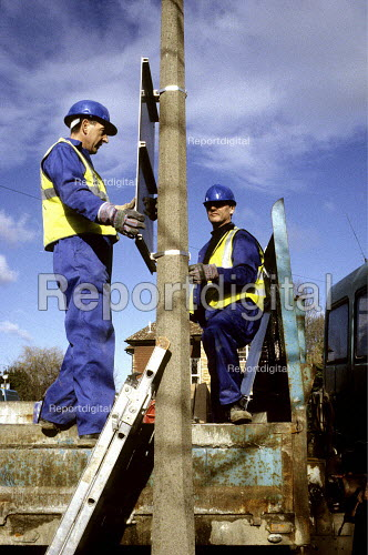 Council workers erecting road safety signs, Harrow, London - Duncan Phillips - 2005-09-29