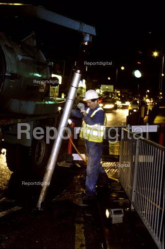A council contractor clearing a storm drain. Harrow. London - Duncan Phillips - 2007-02-09