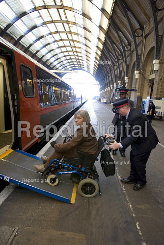Disabled passenger Being assisted off a train, Kings Cross Station - Duncan Phillips - 2005-11-29