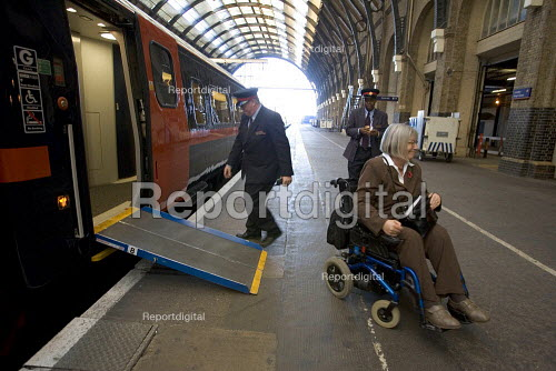Disabled passengerbeing assisted off a train, Kings Cross Station - Duncan Phillips - 2005-11-29