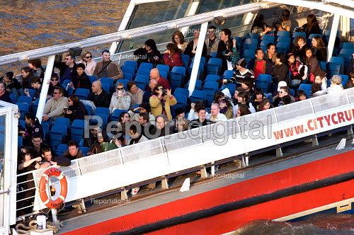 Tourists on a boat trip along the Thames, London - Duncan Phillips - 2009-03-18