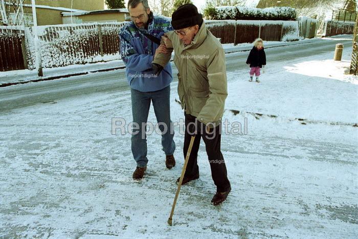 Helping an elderly Gentleman across ungritted street, London - Duncan Phillips - 2003-01-31