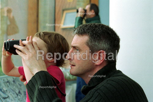 Father and Child bird watching at the London Wetland Centre, Barnes. - Duncan Phillips - 2002-05-11
