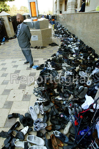 The shoes of Sikh worshipers shoes at the opening of the new gurdwara Temple in Southall, the largest sikh temple in Europe. - Duncan Phillips - 2003-03-30