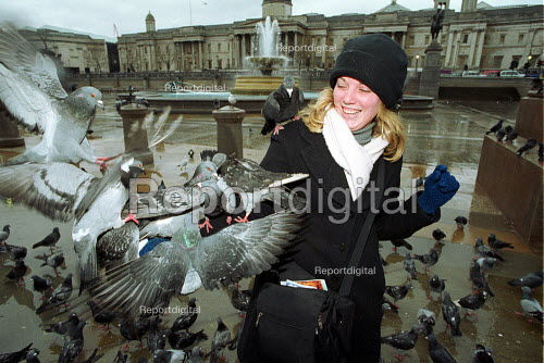 Young woman Feeding pigeons Trafalger Square London - Duncan Phillips - 2001-01-18