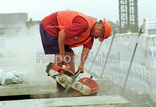 Railway construction worker using an angle grinder to cut concrete. - Duncan Phillips - 2002-07-17