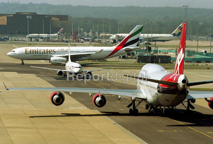 Passenger jets, Gatwick Airport. - Duncan Phillips - 2003-04-17