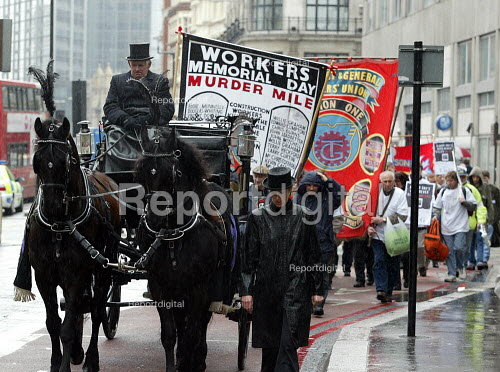 Workers Memorial Day protest. Safety campaigners are led by a horse drawn hearse representing workers who have lost their lives at work. Organised by Construction Safety Campaign. City of London. - Duncan Phillips - 2003-04-28