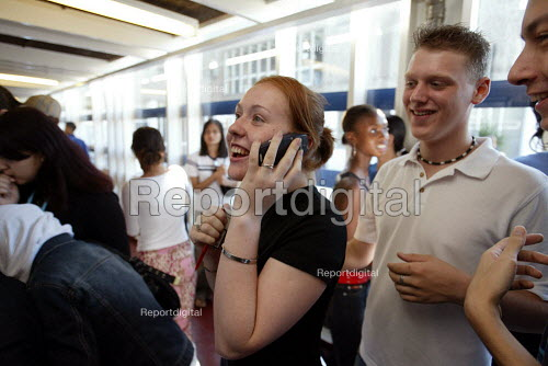 Students collecting A Level Results, Camden, London. Student making a mobile phone call - Duncan Phillips - 2003-08-15