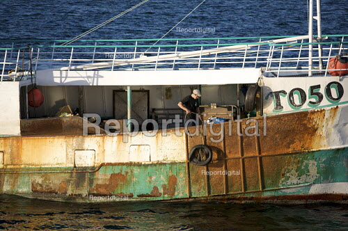 A seafarer onboard a Fishing boat, Penzance, Cornwall - Duncan Phillips - 2010-08-30