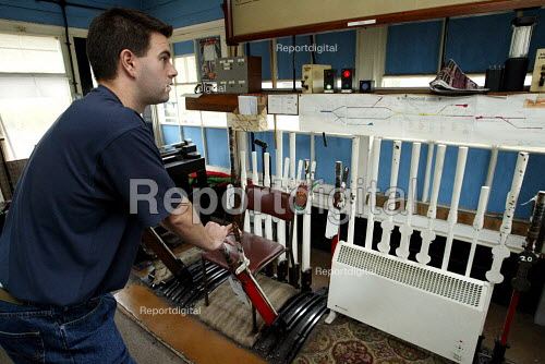 Signalman operating a signal lever in a signal box due to be replaced due to modernisation and investment in the railway. Bishop Stortford - Duncan Phillips - 2003-10-10