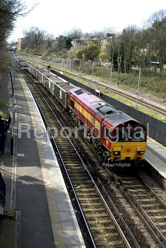 Freight Train passing through a station - Duncan Phillips - 2006-04-06