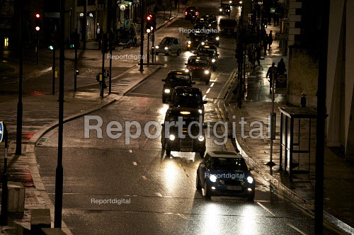 Streams of London Taxis working late in the City of London - Duncan Phillips - 2010-03-30