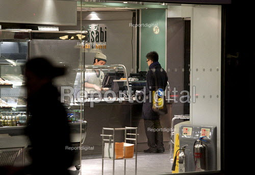 Buying food at a Sushi take away. Working late in the City of London - Duncan Phillips - 2010-03-30