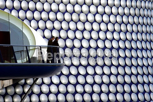 The new Selfridges department store, The Bull Ring Birmingham City centre. Designed by architects Future Systems it is covered in a windowless blue skin, dotted with 15,000 aluminium discs. The organic, flowing shape resembles a giant boobtube, covered with fish scales glinting in the light. The principal architects were Jan Kaplicky and Amanda Levete. - Duncan Phillips - 2004-12-23