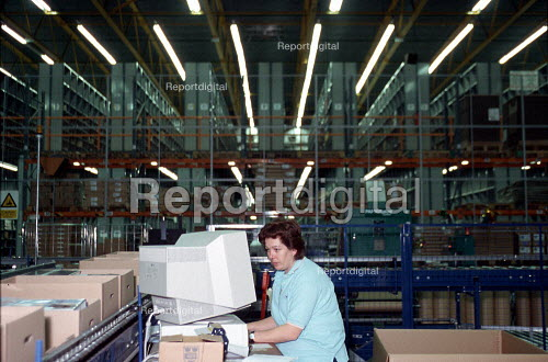 Women worker using computer on production line at OUP automated print distribution centre Corby - John Harris - 1999-12-16