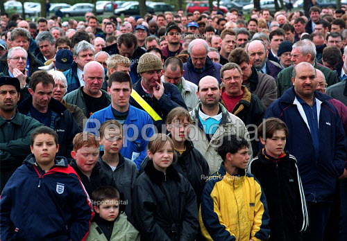 2000 Rolls Royce workers at a mass meeting, MSF and AEEU trades union members listening as local officials informed them of a proposed 2000 redundancies. - John Harris - 2000-04-18