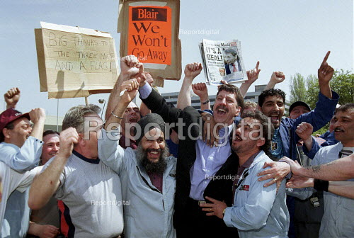 Dr Carl Chinn and Rover workers celebrating the completion of the deal for Phoenix to buy Longbridge Rover from BMW outside the plant. - John Harris - 2000-05-09