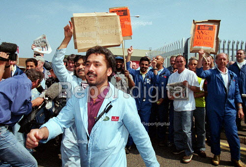Rover workers celebrating the completion of the deal for Phoenix to buy Longbridge Rover from BMW outside the plant. - John Harris - 2000-05-09