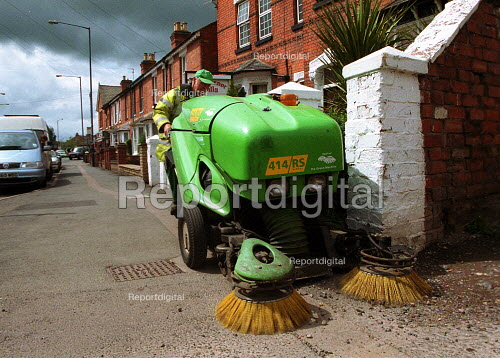 Local authority cleaner sweeping the street. - John Harris - 2000-05-18